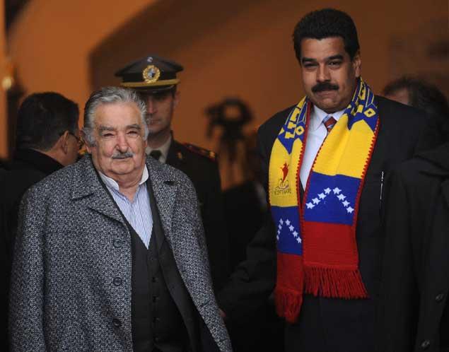 Mujica y Maduro. / AFP.