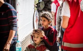 Niños refugiados recién llegados a Croacia. Foto: Cruz Roja internacional.
