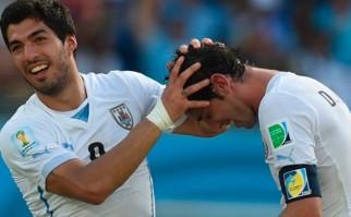 Suárez y Godín candidatos a integrar el equipo ideal de la UEFA. Foto: AFP
