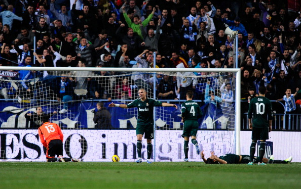 MALAGA, SPAIN - DECEMBER 22:  Real Madrid CF players react dejected after Francisco R. Alarc?n Isco of Malaga CF scored the opening goal during the La Liga match between Malaga CF and Real Madrid CF at La Rosaleda Stadium on December 22, 2012 in Malaga, Spain.  (Photo by David Ramos/Getty Images)