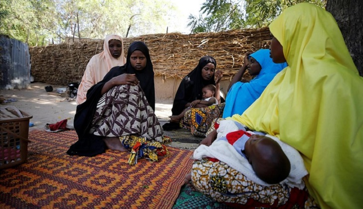 Relatives are seen during a condolence visit to the mother of one of the abducted Government Girls Science Technical College  GGSTC  Dapchi students in Jumbam Village  Yobe State  Nigeria February 24  2018  REUTERS Afolabi Sotunde