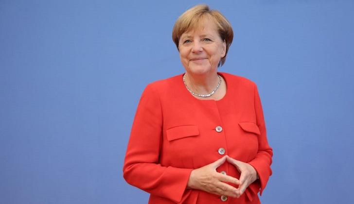 Socialdemócratas de Alemania aprueban una coalición con Angela Merkel .
