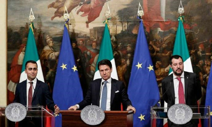 Italian Premier Giuseppe Conte, center, Deputy Premier and Labour and Industry Minister Luigi Di Maio, left, and Deputy Premier and Interior Minister, Matteo Salvini, attend a press conference following a Cabinet meeting at Chigi Palace's premier office in Rome, Thursday, Jan. 17, 2019. The government unveiled details of how it will fulfill two core campaign promises: providing a basic income to needy Italians looking for work, and reforming unpopular pension regulations.  (Riccardo Antimiani/ANSA via AP)